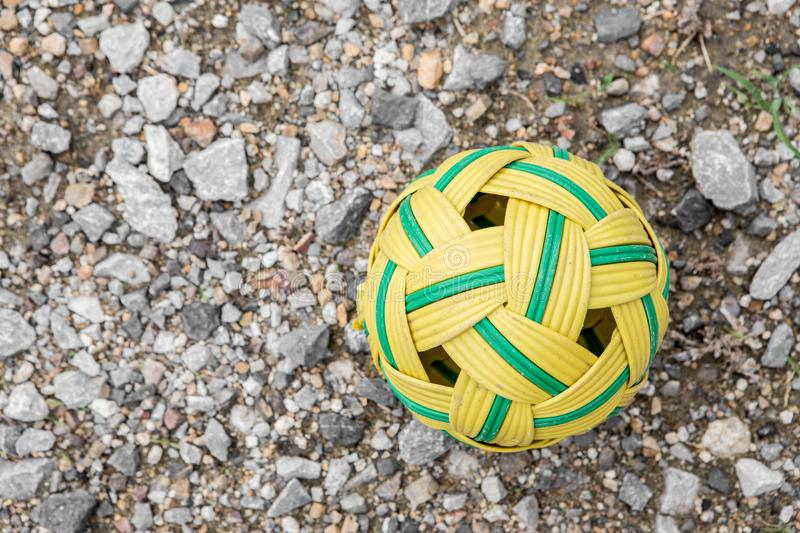 Rattan ball on the ground rubble. Top view of Rattan ball on the ground rubble royalty free stock images