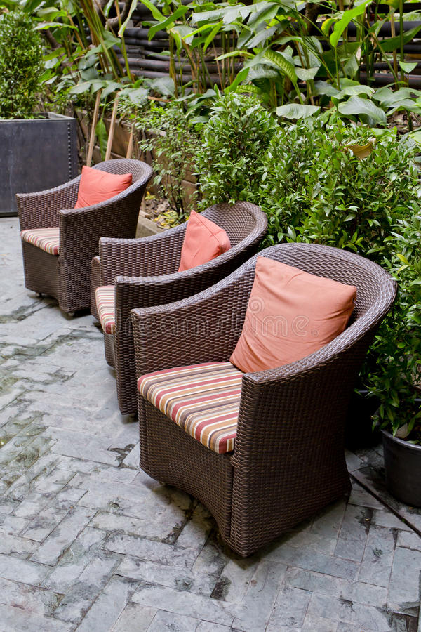 Free Rattan Chair And Rattan Coffee Table With Green Trees At Outdoor Royalty Free Stock Photography - 48695387