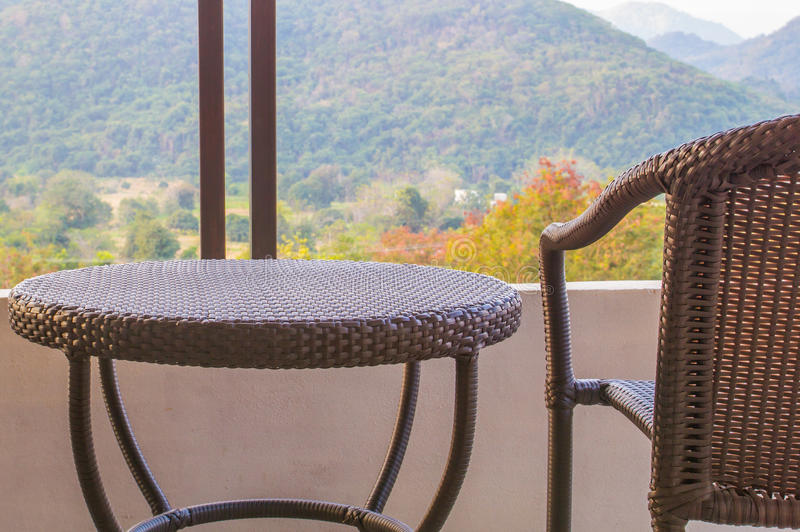 Rattan chair. Rattan of table and chair on balcony royalty free stock images