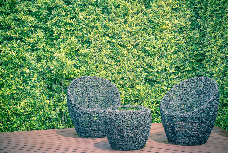 Rattan garden table and chairs royalty free stock photography