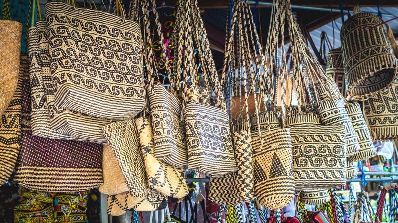 Rattan handbag in front of souvenir shop in Samarinda, Indonesia. Rattan handbag with tribal pattern hanging in front of souvenir shop in Samarinda, Indonesia royalty free stock photo