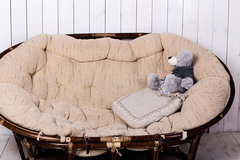 Rattan sofa in a room. Photo of rattan sofa in a room royalty free stock photo