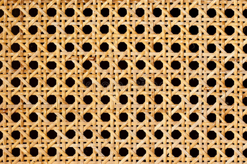 Rattan weave. Closeup of rattan weave isolated on black background royalty free stock photo