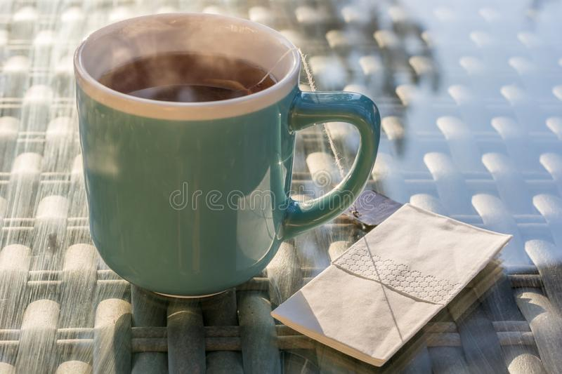 Hot steaming herbal tea with a handkerchief royalty free stock photos