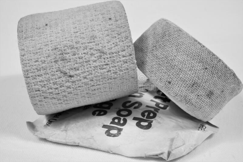 Ratty hardened old medical bandages and soap packet royalty free stock images