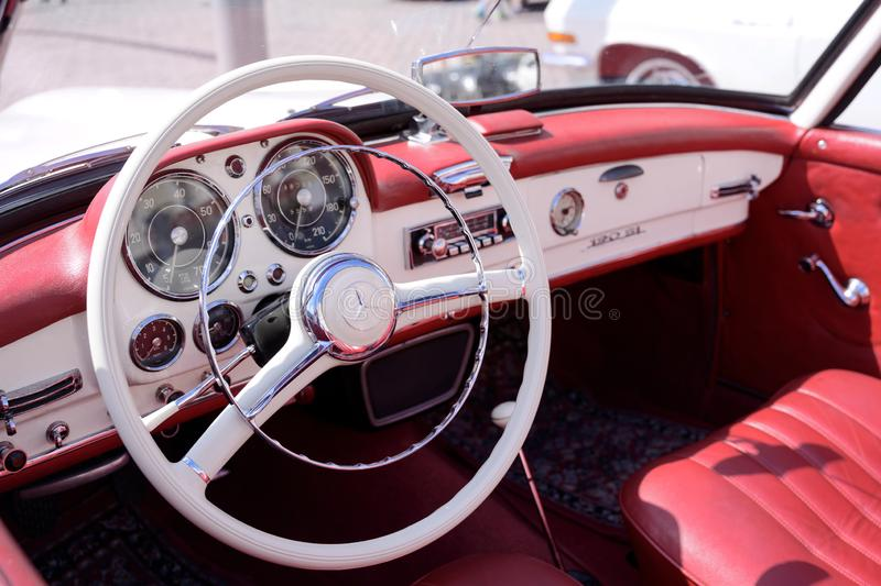 RATZEBURG, GERMANY - JUNE 2, 2019: mercedes 190 sl, cockpit interior of the two-door luxury roadster cabriolet, a classic. Automobile at the oldtimer meeting in royalty free stock photography