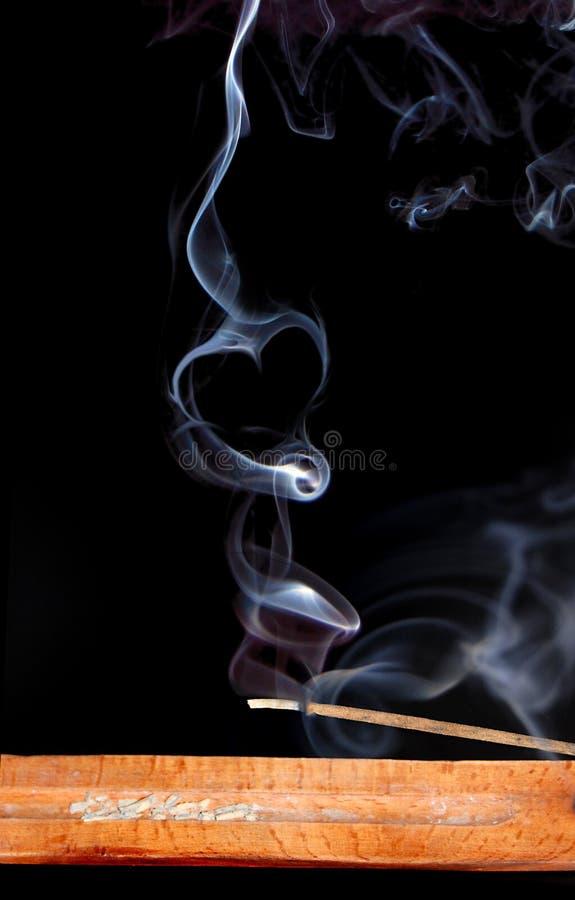 Rauch des Duftes lizenzfreie stockbilder