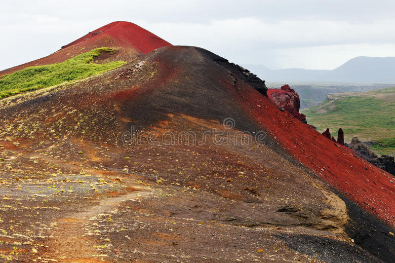 Raudholar, a mountain with red volcanic, Iceland. Raudholar, a mountain with red volcanic ash in Iceland stock photo