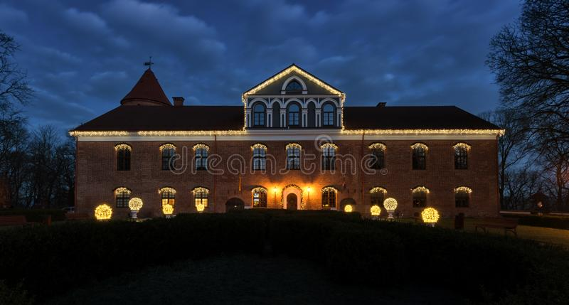 Raudondvaris castle at Christmas night view Lithuania. View of the illuminated castle at Christmas time in Raudondvaris, Lithuania. Raudondvaris castle is a royalty free stock image