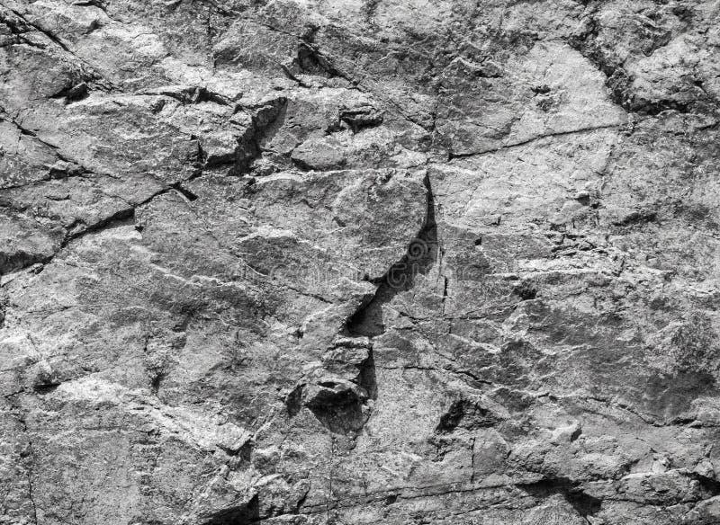 Raue graue Felsenwand, Steinbeschaffenheit stockfoto