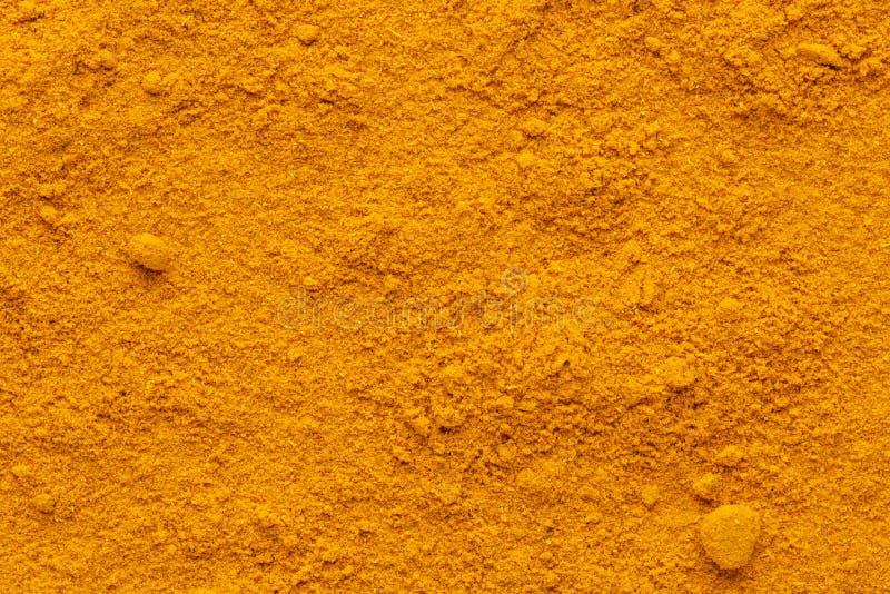 Raue Oberfläche des vollen Grundrahmens des Curry-Pulvers lizenzfreie stockfotografie
