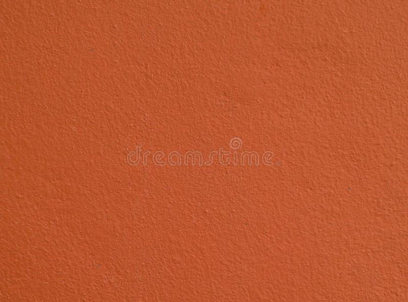 Rauer einfacher orange Betonmauerhintergrund/-beschaffenheit lizenzfreie stockfotografie
