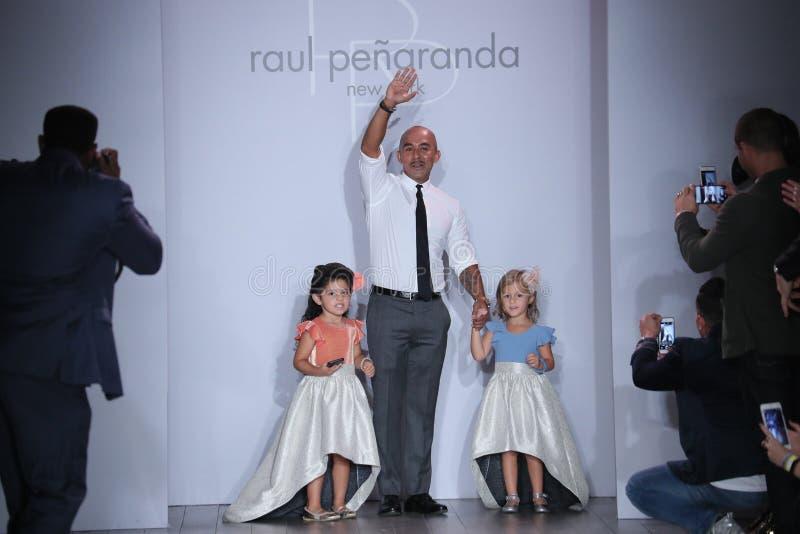 Raul Penaranda and kid models walk the runway during Raul Penaranda Runway show. NEW YORK, NY - SEPTEMBER 13: Raul Penaranda and kid models walk the runway royalty free stock image