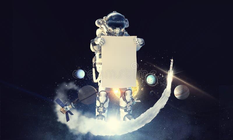 Raumfahrer mit Fahne Gemischte Medien stockbild