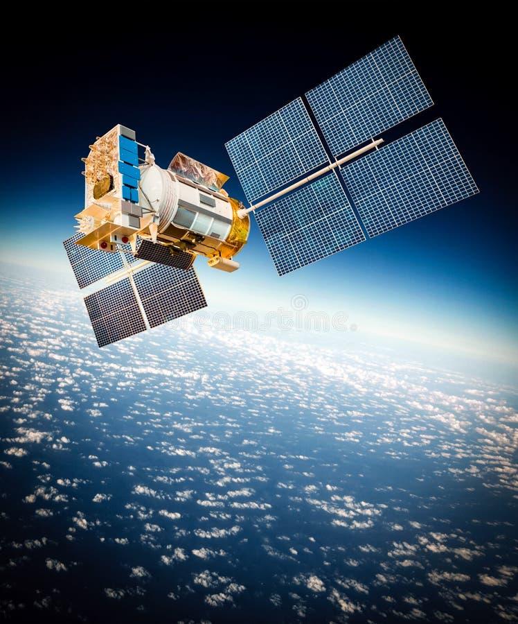 Raumsatellit über der Planetenerde stockbilder
