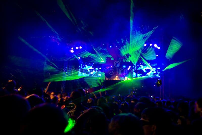 Rave Concert. Disco Party - fantastic green laser show stock images
