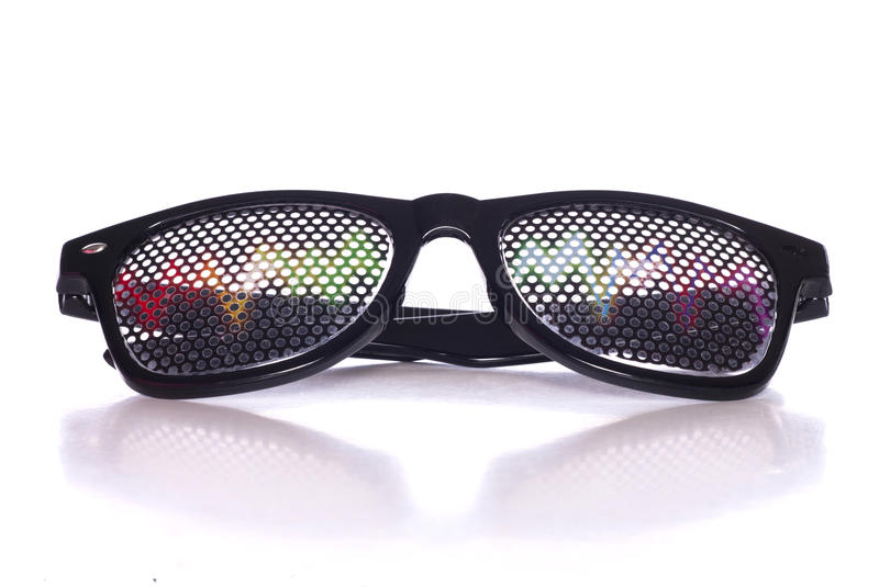 Rave music fancy dress glasses. Studio cutout stock photography
