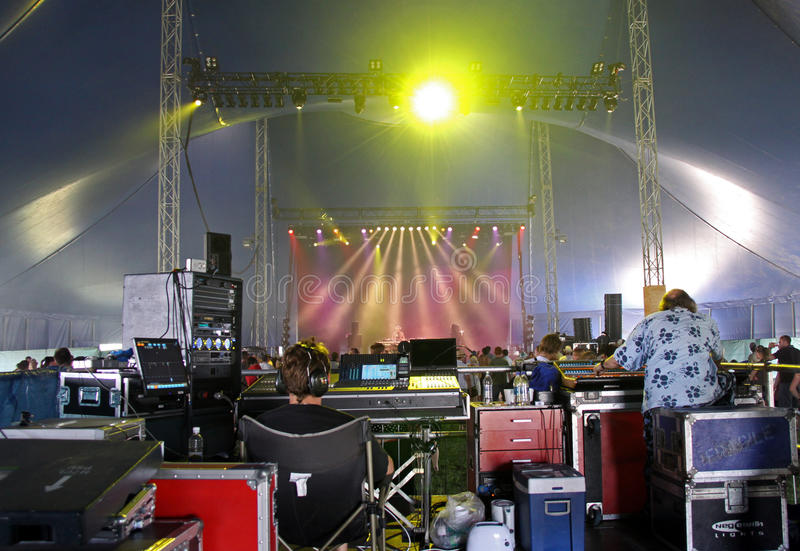 The rave music marquee at Hop Farm Music Festival. Hop Farm Music Festival, Kent, UK 4th July 2009 inside the rave / dance tent showing a dj on stage with crowd royalty free stock photography