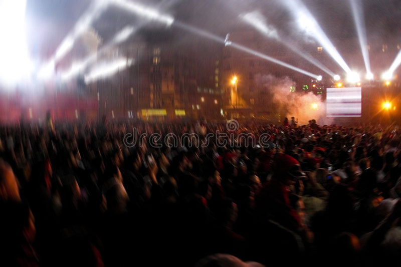 Rave party. A blurred image of a large crowd, gathered together for a rave party royalty free stock photo