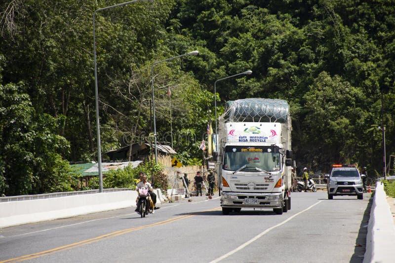 Ravelers thai people stop vehicle on road bridge crossing Bang Lang Reservoir for travel visit view of Pattani Dam at Bannang Sata. YALA, THAILAND - August 16 stock photography