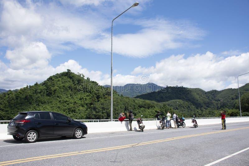 Ravelers thai people stop vehicle on road bridge crossing Bang Lang Reservoir for travel visit view of Pattani Dam at Bannang Sata. YALA, THAILAND - August 16 stock images