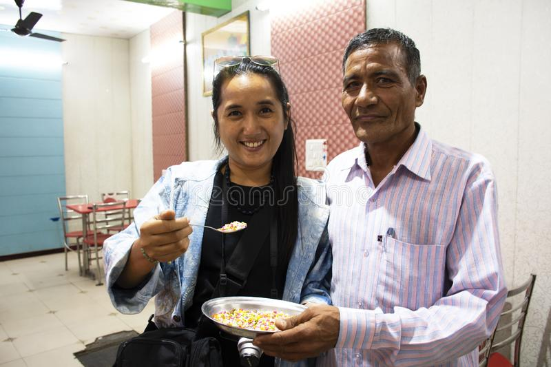 Thai women journey visit and travel posing portrait take photo with Indian man people owner local restaurant at New Delhi, India. Ravelers thai women journey stock image