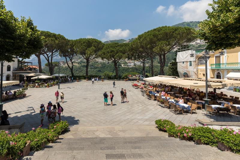 Tourists enjoy the atmosphere of Ravello`s Piazza Duomo. Amalfi Coast. Italy. Ravello, Italy - June 16, 2017: Tourists enjoy the atmosphere of Ravello`s Piazza royalty free stock images