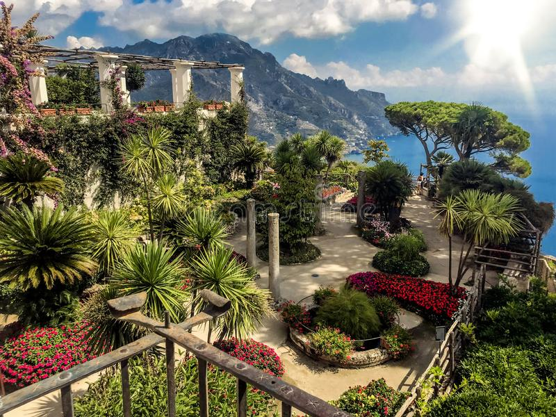 Ravello, Italy, September 7, 2018: Picture postcard with terrace with flowers in the garden Villas Rufolo in Ravello. Amalfi Coast stock photos