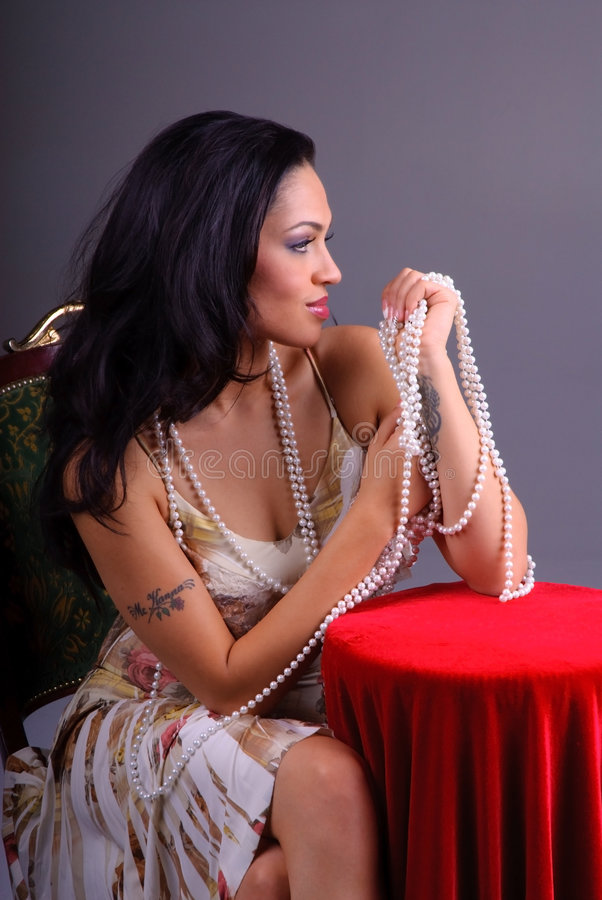 Raven Haired Beauty and Pearls royalty free stock images