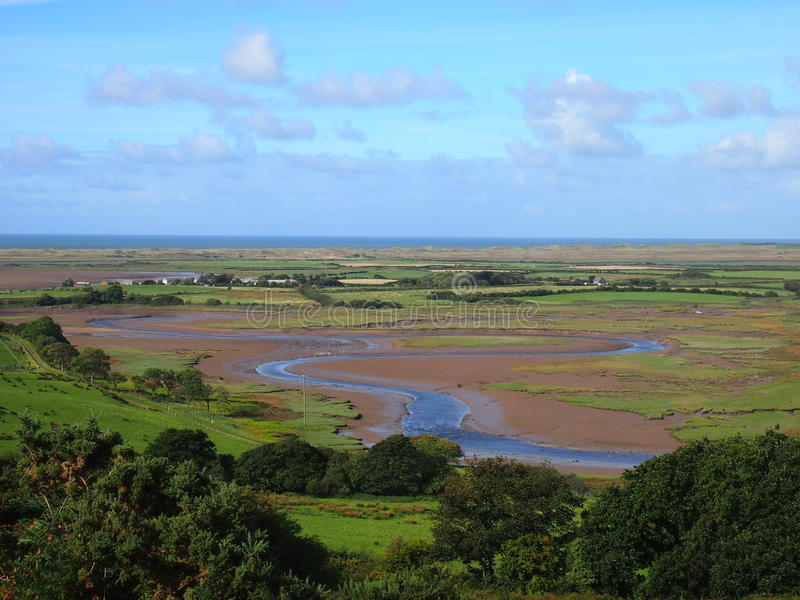 Ravenglass, Northern England. The river Mite flowing into the Irish Sea at the estuary at Ravenglass, Cumbria stock images