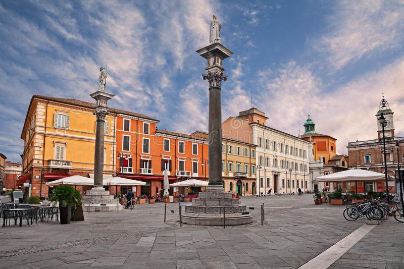 Ravenna, Emilia-Romagna, Italy: the main square Piazza del Popolo with the ancient columns with the statues of Saint Apollinare. Ravenna, Emilia-Romagna, Italy stock images
