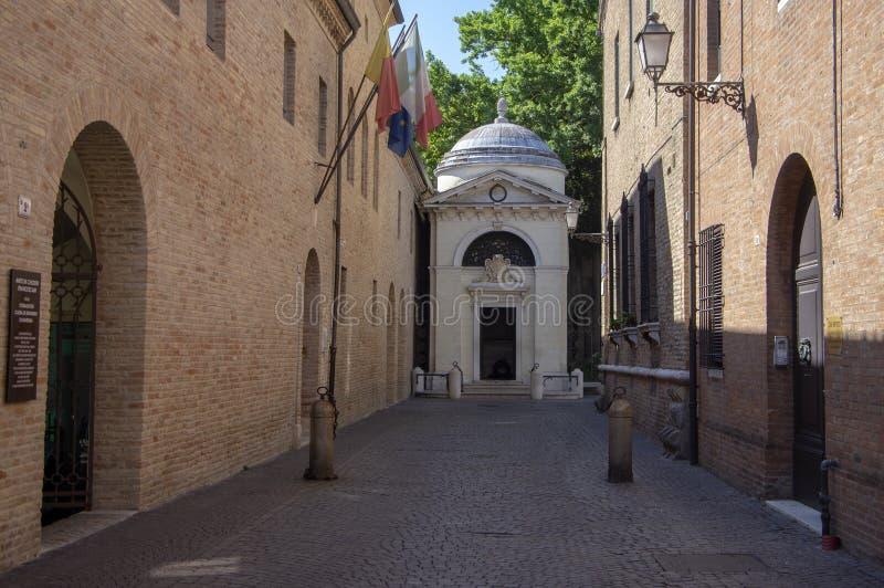 Ravenna / ITALY - June 20, 2018: Dante Alighieri tomb hidden on the end of narrow italian street. Beautiful summer day with sunlight stock images