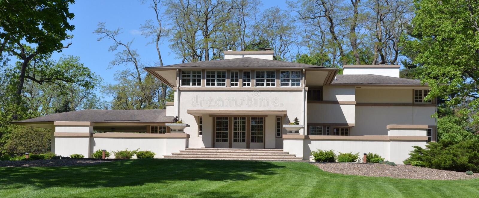 Ravine House. This is a Spring picture of the Mrs. A.W. Grisly House in Batavia, Llinois. The house designed by Frank Lloyd Wright was called the Ravine House by stock photos