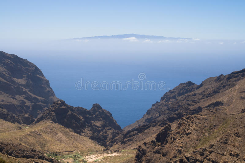 Ravine of Masca and La Gomera. Ravine of Masca with the island of La Gomera in the background, Canary Islands royalty free stock photos