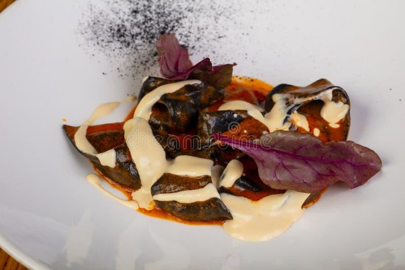 Ravioli med krabban arkivbild
