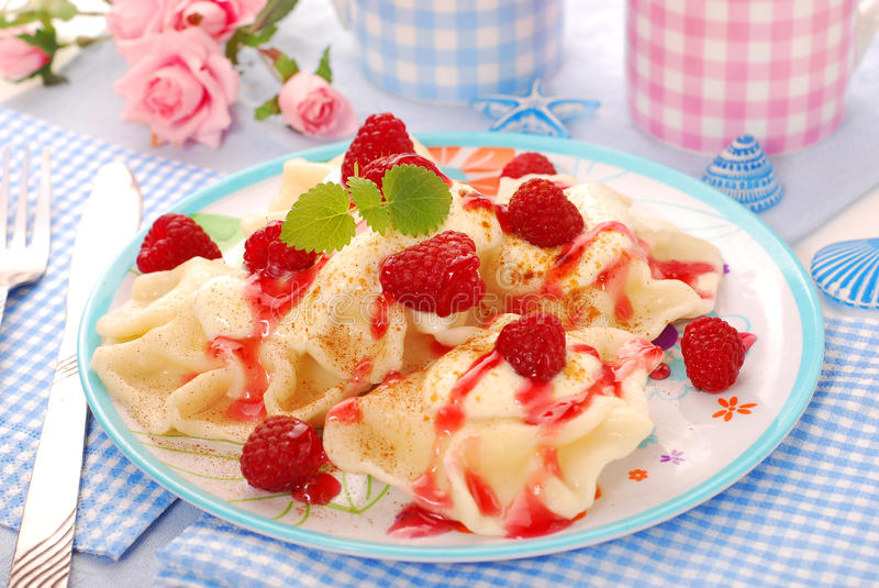 Ravioli (pierogi) with cheese and raspberry royalty free stock image