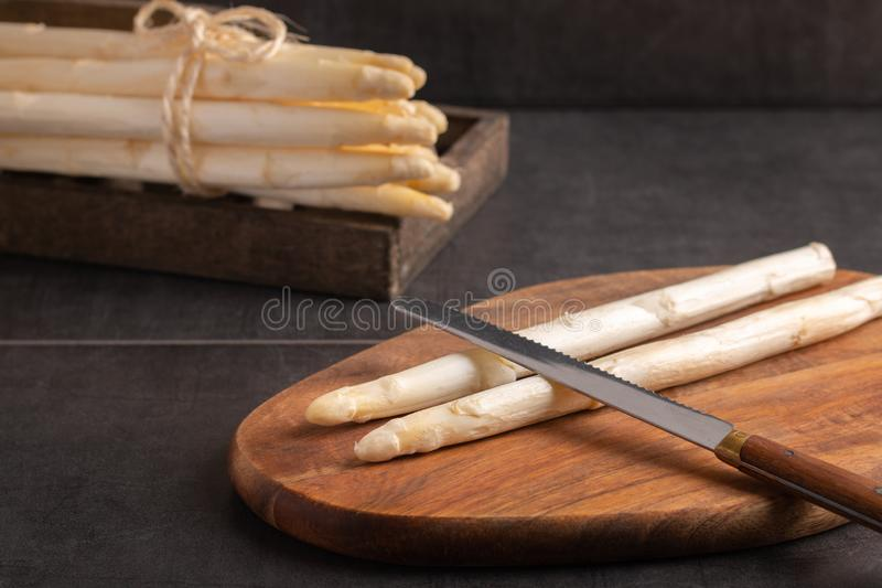 Raw asparagus on a cutting board stock images