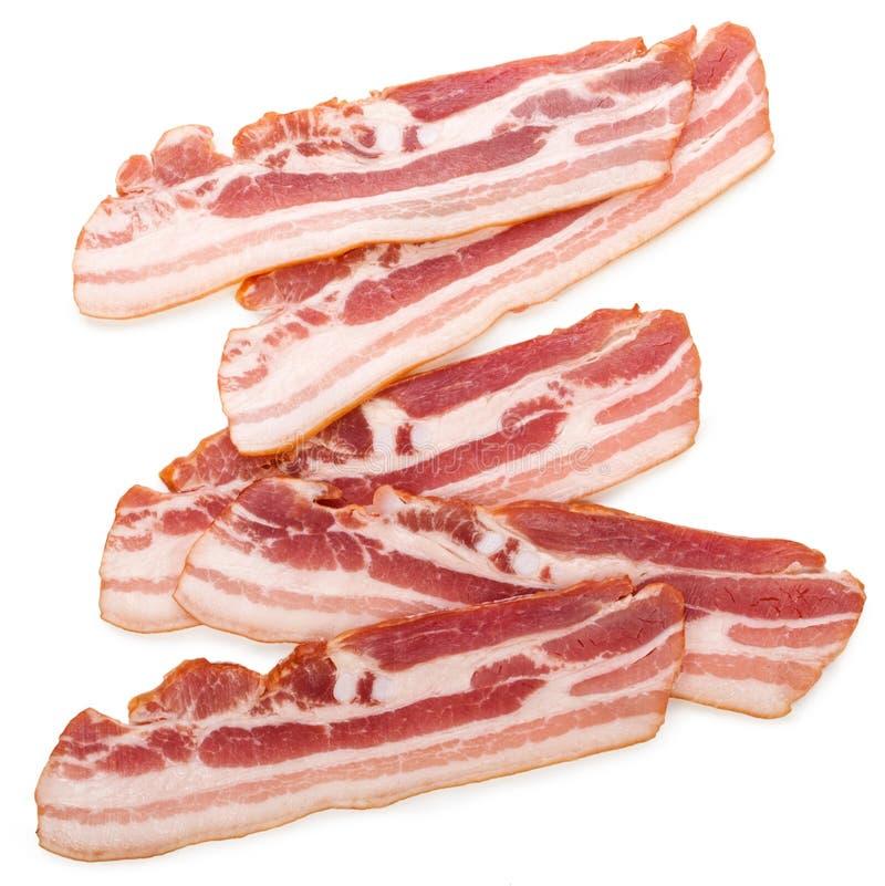 Raw bacon isolated on white background.  stock photo