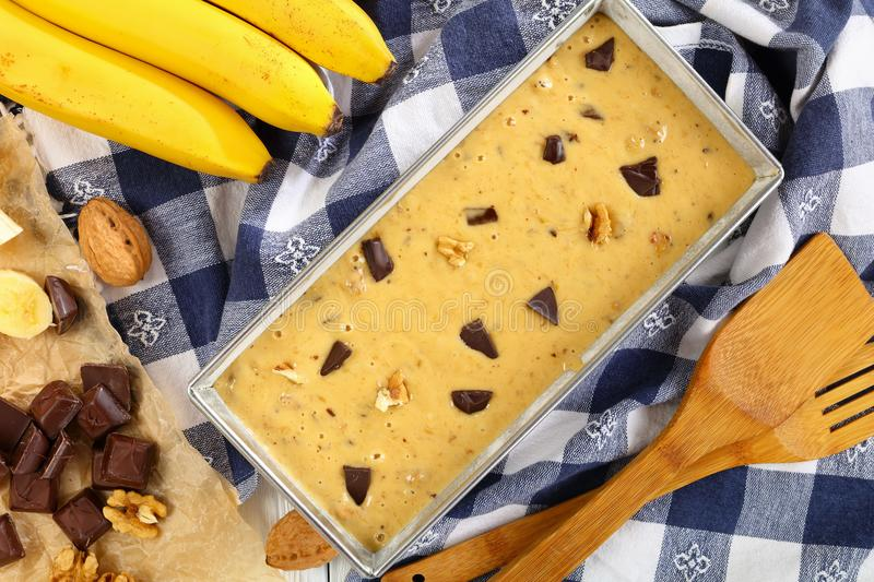 Raw banana bread dough in a loaf pan royalty free stock photography