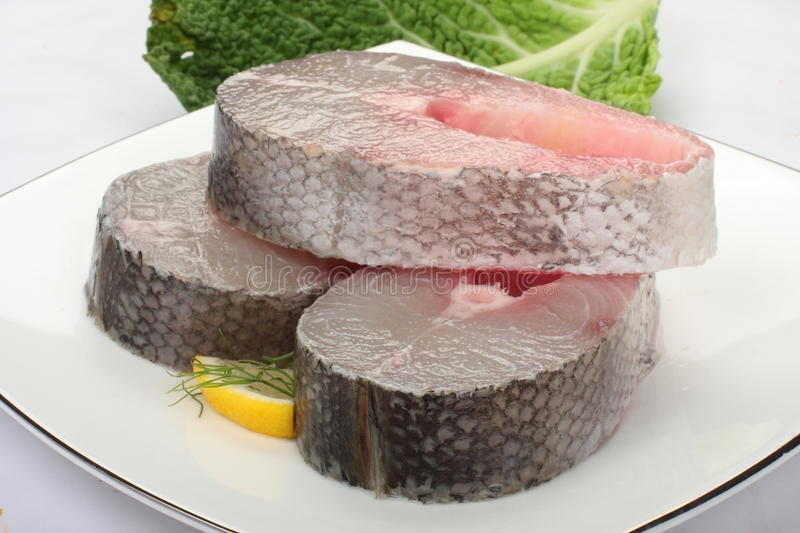 Raw Barracuda slices. Raw Barracuda with skin in white plate royalty free stock photography