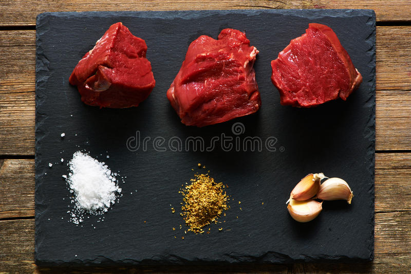 Raw beef filet mignon. Meat over slate stock photos