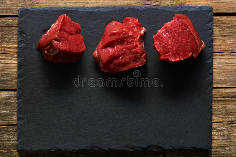 Raw beef filet mignon. Meat over slate royalty free stock images