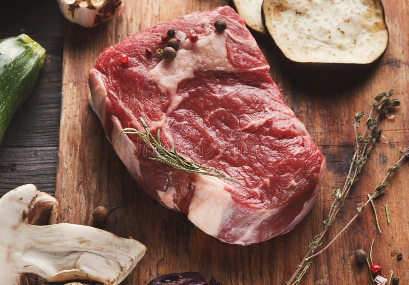 Raw beef filet mignon steak on wooden board stock photos