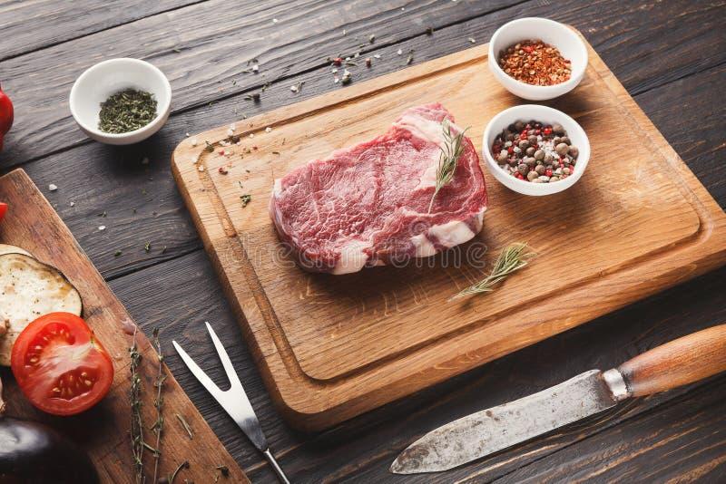 Raw beef filet mignon steak on wooden board royalty free stock photos