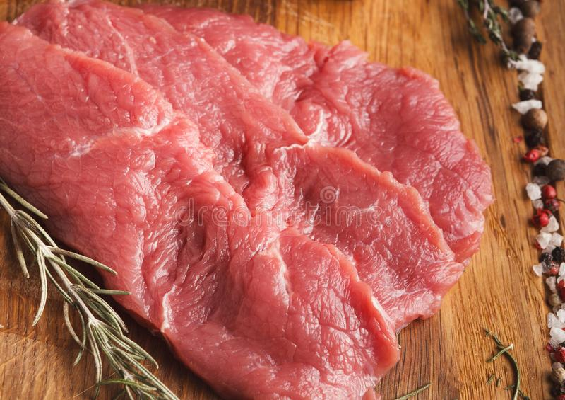 Raw beef filet mignon steaks on wooden board stock photos
