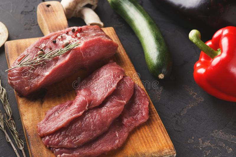 Raw beef filet mignon steaks on wooden board royalty free stock photo