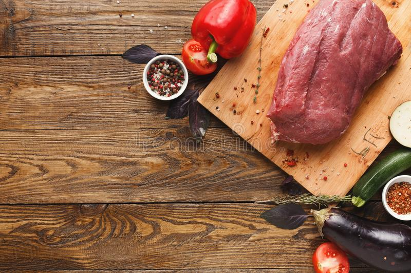 Raw beef filet mignon steaks on wooden board royalty free stock photography