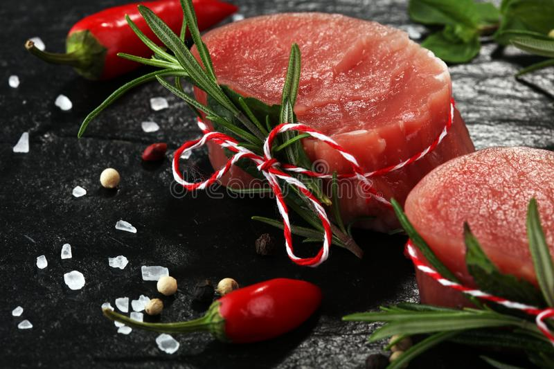 Raw beef fillet steaks mignon on dark background.  royalty free stock photo