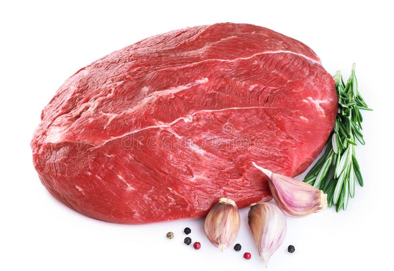Raw beef meat, garlic, pepper and rosemary royalty free stock images