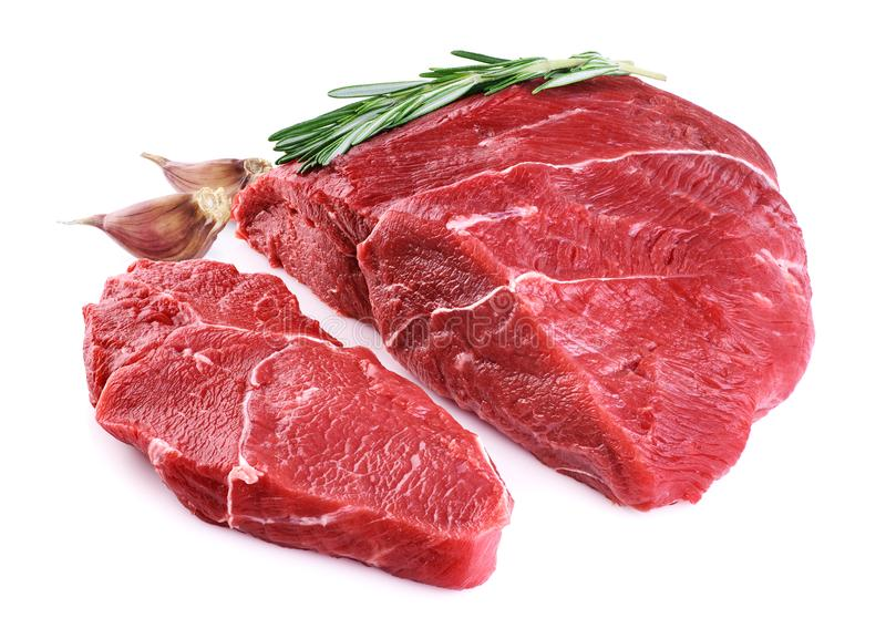 Raw beef meat, garlic and rosemary royalty free stock photos
